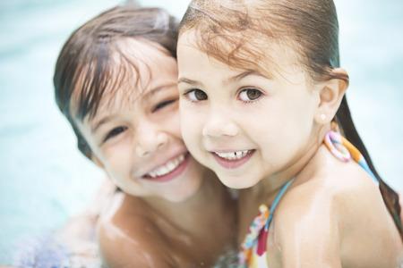swim goggles: Little friends having fun in swimming pool
