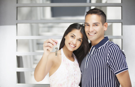 latin couple: Happy latin couple with home keys