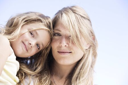 blonde blue eyes: Blonde mother and daughter portrait