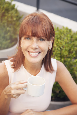 one mature woman only: Happy woman drinking coffee Stock Photo