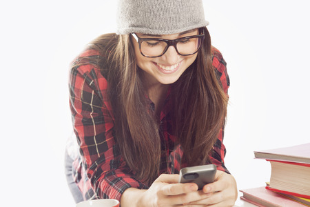 cel: Happy woman sending text message Stock Photo