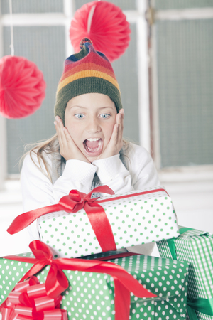 early teens: Girl with Christmas presents Stock Photo