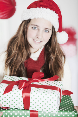 early teens: Happy girl with Christmas presents
