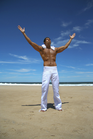 pectoral: Happy man on the beach Stock Photo
