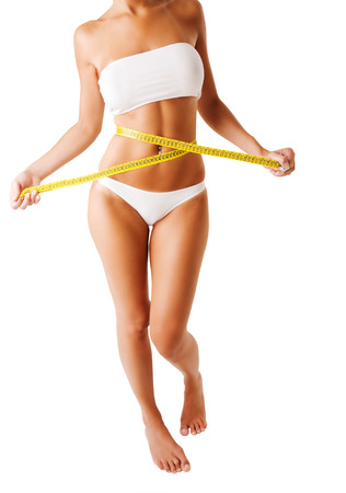 plastic surgery: Fit woman body with centimeter Stock Photo