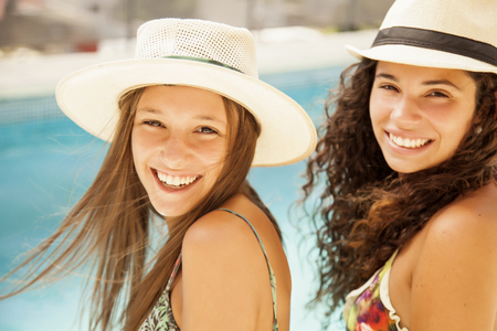 hot lady: Happy friends in swimming pool Stock Photo
