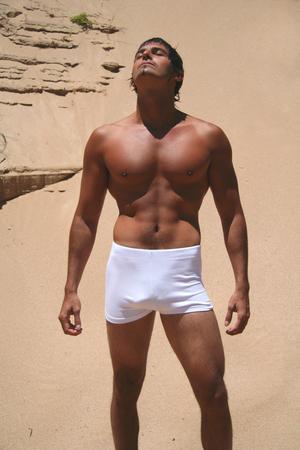Sexy man sunbathing Stock Photo
