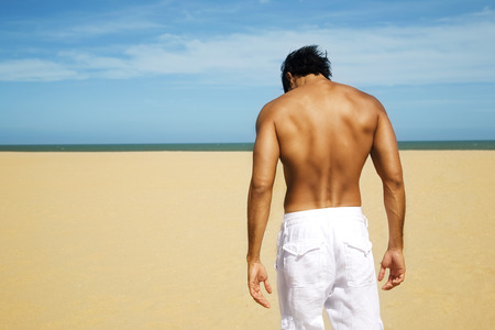 ビーチでセクシーな男 写真素材