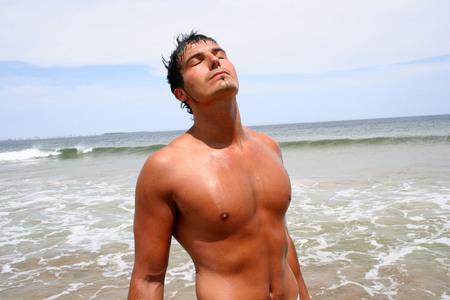 beach model: Sexy man sunbathing on the beach Stock Photo