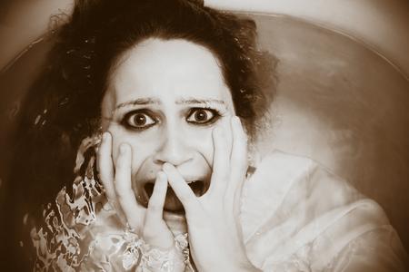 horrified: Woman in bathtub Stock Photo