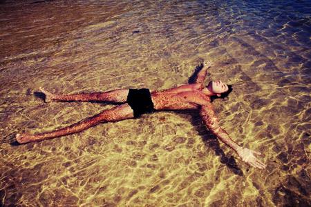 flotating: Man relaxing flotating in the ocean