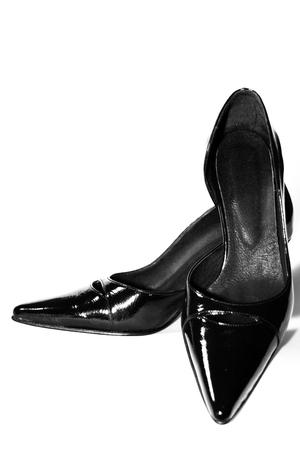 fetish wear: Black shoes isolated on white