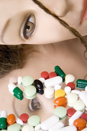 face to face: Mannequin face and pills