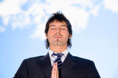 man meditating: Business man meditating