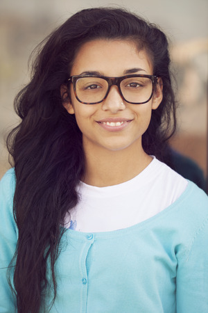 smiling teenagers: Young indian woman with glasses