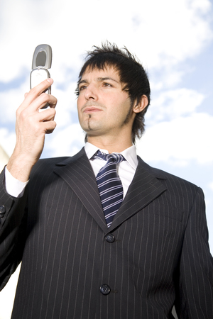 cel: Business man with mobile phone Stock Photo