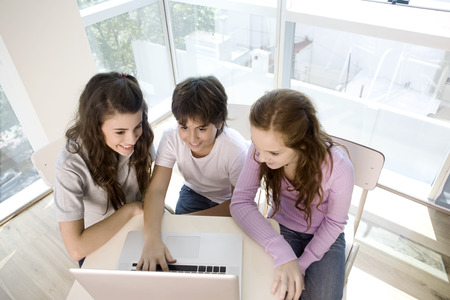 school teens: Teen group of students with computer at school