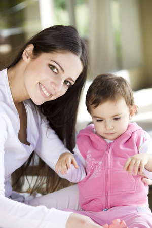 sitter: Young woman and baby girl playing