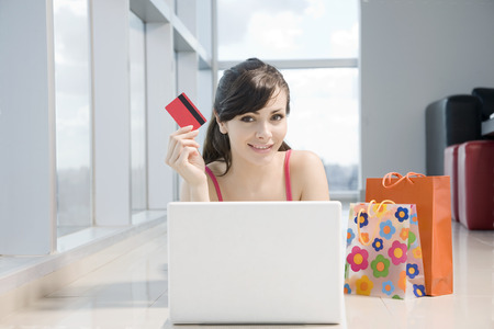 shopping online: Happy woman shopping online