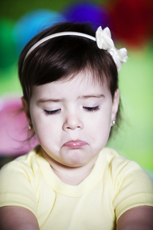 sulking: Little girl sulking