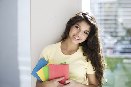 smart girl: Teen student with books
