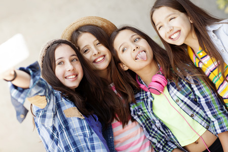 happy teenagers: Group of friends taking a self portrait Stock Photo