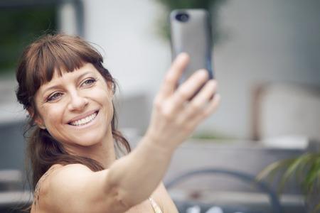 self   portrait: Woman taking a self portrait Stock Photo