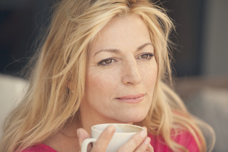 attractive female: Blonde adult woman drinking coffee