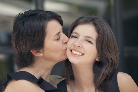 mother kissing daughter: Mother kissing daughter