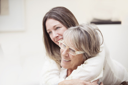 elderly: Happy senior mother and daughter