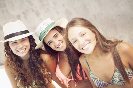 pool water: Happy teen girls enjoying summer