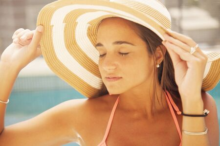 teen girls: Woman with hat in swimming pool Stock Photo