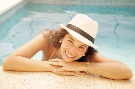 pretty teen: Happy teen girl in swimming pool