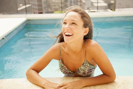 teen bikini: Happy teen girl in swimming pool