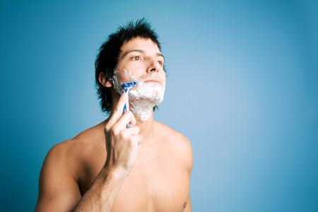 blue face: Latin man shaving Stock Photo