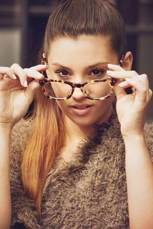 woman wearing glasses: Beautiful woman wearing glasses Stock Photo