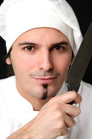 young knife: Young cook with knife