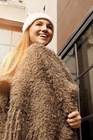 poncho: Happy young woman wearing a poncho