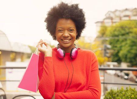 african american woman: African american woman with shopping bag