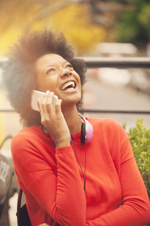 cel: African american woman on the phone Stock Photo