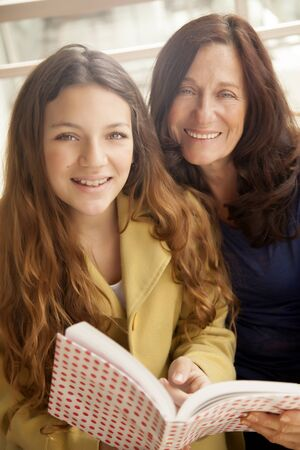 grandaughter: Girl and grandmother studying Stock Photo