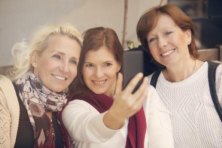 cel: Group of mature woman taking a self portrait