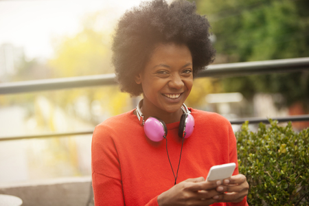woman on phone: Afro woman with phone