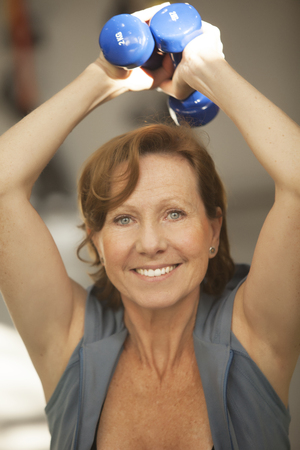 senior woman exercising: Senior woman exercising with dumbbells