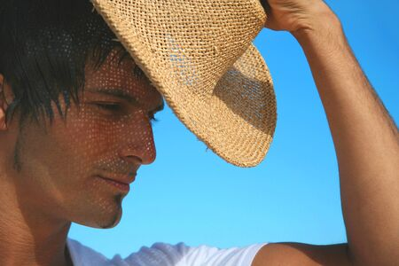 straw the hat: Man wearing straw hat against blue sky