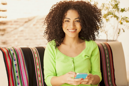 cel: African american woman having fun with mobile phone Stock Photo