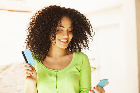 African american woman shoping with credit card and mobile phone