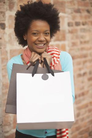 african american woman: African american woman with shopping bags Stock Photo