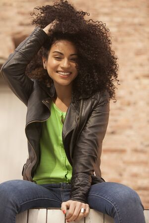 african american woman: African american young woman having fun outdoors