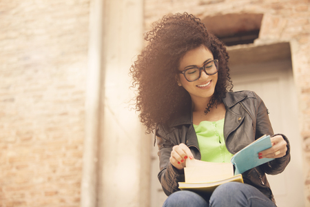 african american woman: Happy african american woman reading book Stock Photo